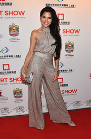 Joyce Giraud arrived at the LA Art Show Opening Night Premiere Party shimmering in a halter jumpsuit in silver.