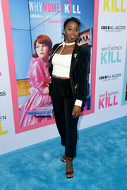 Kirby Howell-Baptiste teamed a black velvet pantsuit with a white crop-top for the LA premiere of 'Why Women Kill.'
