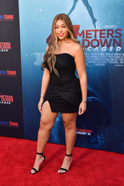 Jordyn Woods turned heads in a strapless, skintight LBD at the premiere of '47 Meters Down Uncaged.'