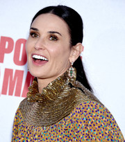Demi Moore polished off her look with a pair of dangling diamond earrings by Bulgari.