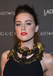 Amber Heard's bright red lipstick was the perfect finishing touch for her Art + Film Gala look.