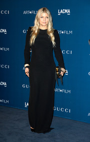 Fergie attended the LACMA Art + Film Gala wearing a simple yet elegant long-sleeve black evening dress by Versace.