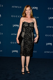 Marg Helgenberger completed her classy ensemble with a pair of black cross-strap sandals.