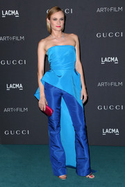 Diane Kruger paired her top with silk pants in a deeper shade of blue, also by Monique Lhuillier.