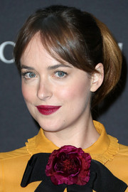 Dakota Johnson's raspberry lipstick contrasted beautifully with her yellow dress.
