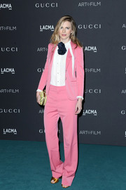 Brit Marling attended the LACMA Art + Film Gala wearing a pink jacket and pants combo by Gucci--an ultra-girly way to suit up!