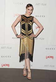 Evan Rachel Wood channeled '20s glamor at the LACMA fete in a black and gold beaded dress. She topped off the look with strappy sandals.
