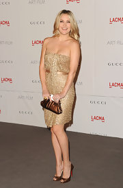 Kate Hudson showed off her post-baby bod at the LACMA event in a  gold cocktail dress. She topped off her look with bronze peep-toe pumps.