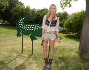 A pair of studded boots completed Laura Whitmore's ensemble at Lacsote's Beautiful Desert Pool Party.