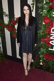 Michelle Trachtenberg layered a beaded navy dress under a velvet coat for total elegance at the Land of Distraction launch.