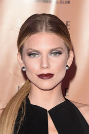 AnnaLynne McCord donned a sleek loose ponytail at the LAPALME Magazine Winter Soiree.