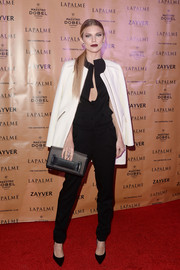 AnnaLynne McCord rocked a black jumpsuit that she paired with a white coat at the LAPALME Magazine Winter Soiree.