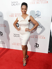 Monique showed off her toned arms with a square-shoulder ivory cocktail dress.