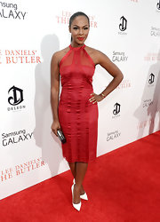 Tika's ruby red halter dress showed off her fit figure at the premiere of 'The Butler' in NYC.