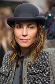 Noomi Rapace accessorized with a gray bowler hat for a bit of flair at the Antonio Berardi fashion show.