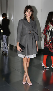 Alexa Chung accessorized a classic and cute look with the perfect little black clutch.