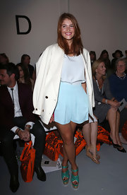 Gemma wore this cute pair of baby blue trouser shorts with cream layers to sit front row at the Holly Fulton fashion show.