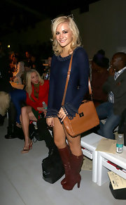 Pixie Lott styled her London Fashion Week wears with a structured tan leather satchel.