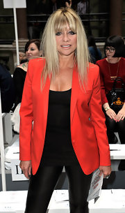 Jo Wood was snapped front row at a Vivienne Westwood fashion show wearing an eyecatching orange blazer.