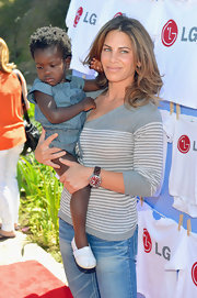 Jillian Michaels attended the launch of LG's new washer wearing a striped gray knit top and jeans.