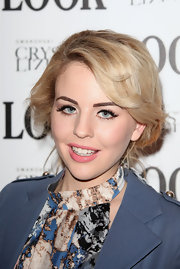 Lydia Bright wore a cheerful shade of peachy-pink lipstick at the 'LOOK' magazine 5th Birthday Party.