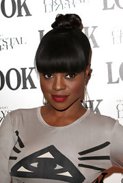 Keisha Buchanan attended the 'LOOK' magazine 5th Birthday Party wearing a rich matte red lipstick.