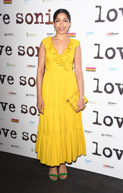 Freida Pinto went for a striking color combo, pairing her yellow dress with green sandals.
