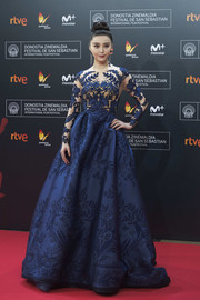 Fan Bingbing commanded attention in a blue Zuhair Murad Couture jacquard ball gown with a tattoo-effect bodice during the San Sebastian Film Festival premiere of 'La Fille de Brest.'