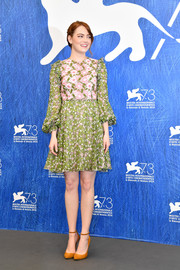Emma Stone went for retro cuteness in a green and pink floral-embroidered dress by Giambattista Valli at the Venice Film Fest photocall for 'La La Land.'