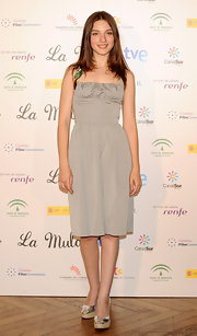 Maria Valverde wore silver peep-toe pumps with her cocktail dress for a sparkly finish.