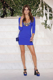 Isabeli Fontana was sultry on the La Perla runway in an electric-blue mini dress with a plunging neckline that exposed her lace bra.