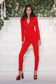 Liu Wen struck a pose on the La Perla runway wearing a skintight red pantsuit.
