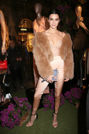 Kendall Jenner looked seductive in a sheer lace bodysuit by La Perla while attending the brand's presentation.