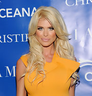 Victoria Silvstedt completed her bronzed and smoky-eyed look with a glossy nude lip glaze.