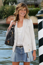 Vittoria flashed a smile for the paparazzi looking young and fresh in her blazer and short denim skirt.