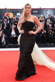 Lady Kitty Spencer oozed elegance wearing this strapless, shutter-pleat gown by Ermanno Scervino at the 2019 Venice Film Festival opening ceremony.