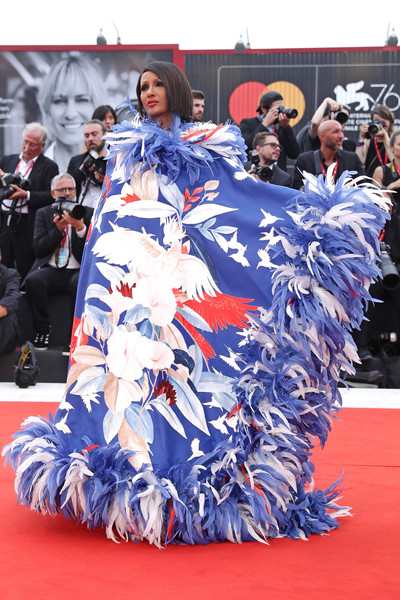 Iman made a spectacular entrance in a feather-trimmed bird-print cape by Valentino Couture at the 2019 Venice Film Festival opening ceremony.