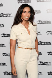 Padma Lakshmi attended the Celebrity Charades Gala wearing a white jumpsuit styled with a studded tan belt.