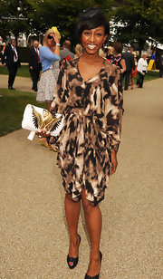 Beverly Knight paired her abstract print dress with an embroidered envelope clutch.