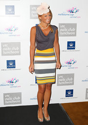 Simone Callahan wore a draped cocktail dress with a striped skirt for the Ladies Luncheon at Crown Palladium.
