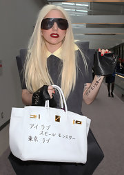 "Unless we're mistaken it appears that Miss Gaga has written all over her pricey white leather ""Birkin"" bag. Ouch!"