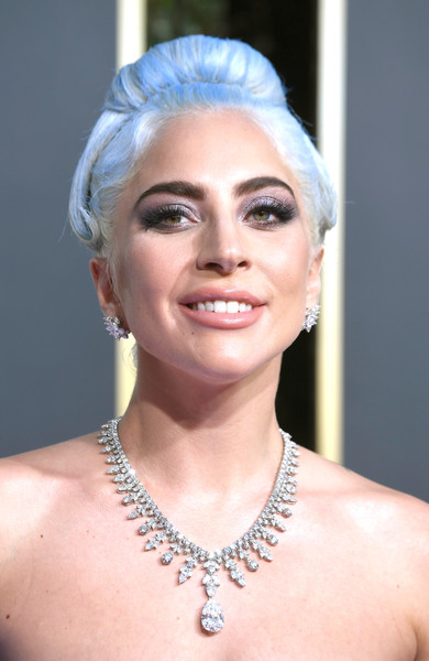 Lady Gaga Classic Bun [jewellery,hair,eyebrow,beauty,human hair color,hairstyle,chin,forehead,shoulder,neck,arrivals,lady gaga,golden globe awards,hair,jewellery,eyebrow,hairstyle,california,beverly hills,the beverly hilton hotel,lady gaga,76th golden globe awards,a star is born,73rd golden globe awards,golden globe award,celebrity,award,actor,film,golden globe award for best screenplay - motion picture]
