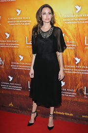 Angelina Jolie wore a lacy chiffon LBD for the premiere of 'The Lady.'