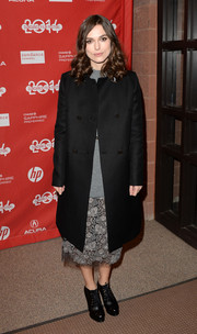 Keira Knightley arrived for the 'Laggies' premiere wearing a black wool coat over a sweater and lace skirt combo.