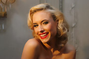 Alena shows off her cherry red lips and Marilyn Monroe mole for a party.