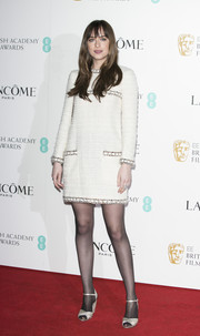 Dakota Johnson complemented her dress with white peep-toe ankle-strap heels by Tabitha Simmons.