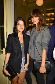 Leandra Medine accessorized with a black Chanel satin clutch for a more elegant finish.