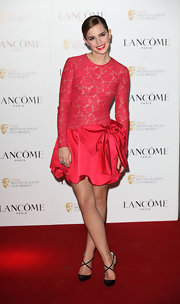 Emma Watson showed off her ultra-girly side in this drop-waist bow-adorned lace dress.