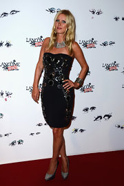 Nicky added some spice to her red carpet look by donning this strapless bejeweled dress.