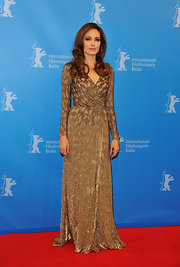 Angelina Jolie wore this gorgeous bronze beaded wrap dress with a subtle leopard print to the premiere of 'In the Land of Blood and Honey.'